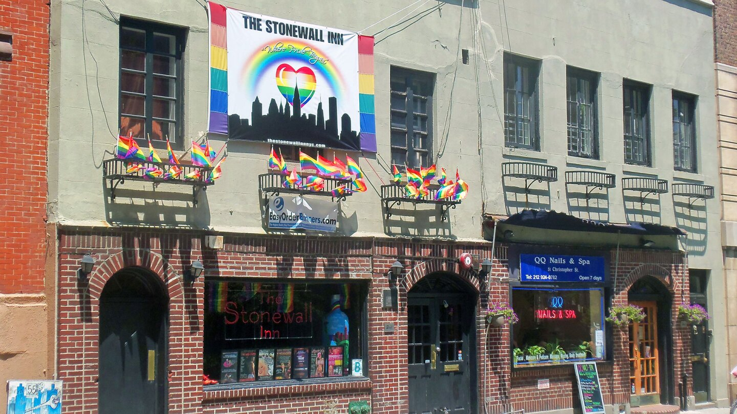 Stonewall Inn, birthplace of the modern gay-rights movement, festooned with gay-pride banners and flags the weekend after Gay Pride Day. | Wikimedia / GNU Free Documentation License