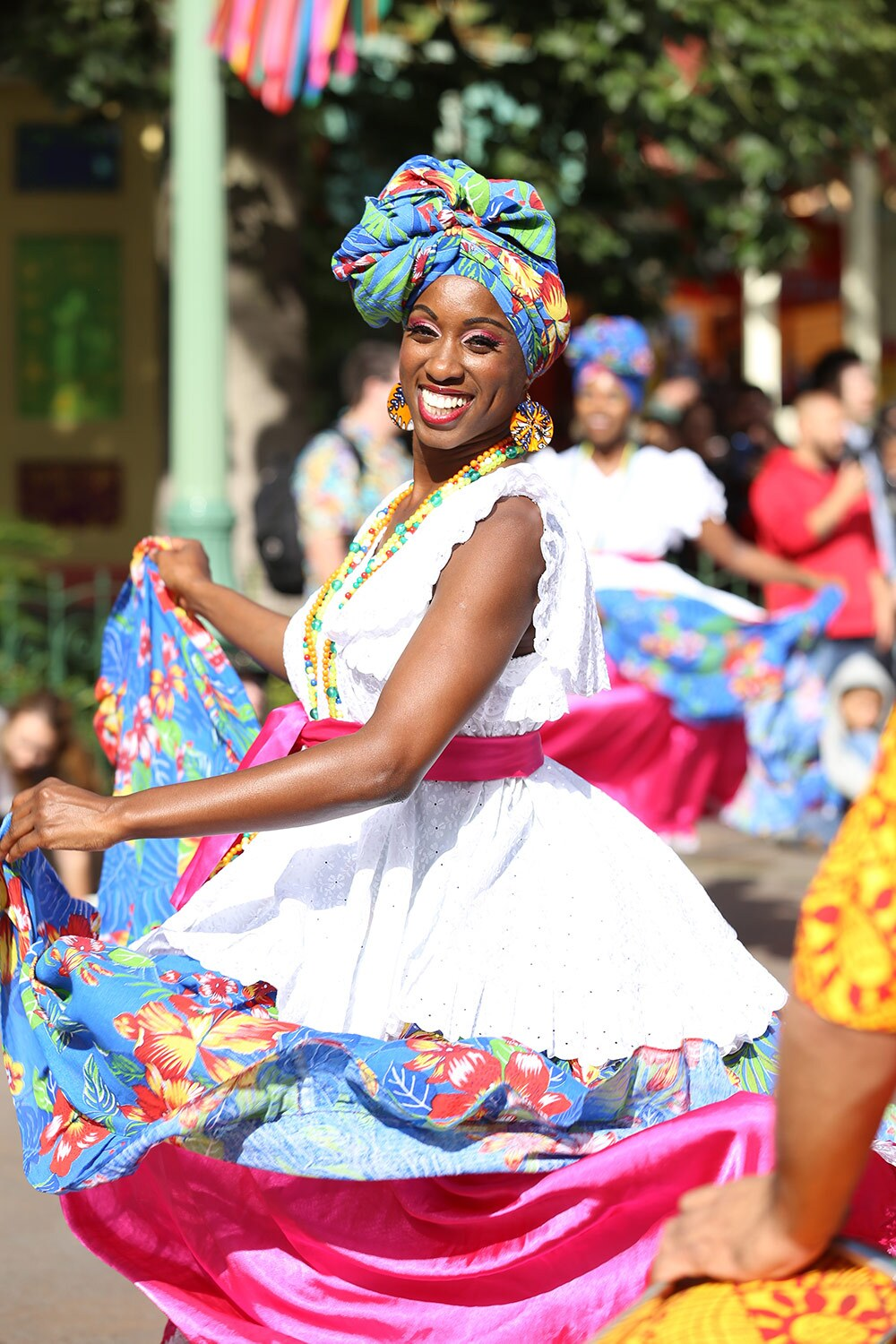 Laroyeana, a Viver Brasil dancer, during Disney California Adventure Park's ¡Viva Navidad! Street Party parade | Courtesy of Viver Brasil
