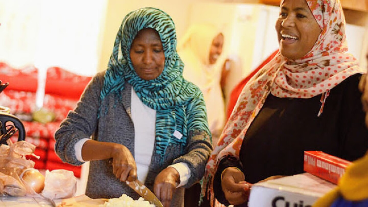 Two participants of Bilal and Baraka preparing food. | Courtesy of United Women of East Africa Support Team