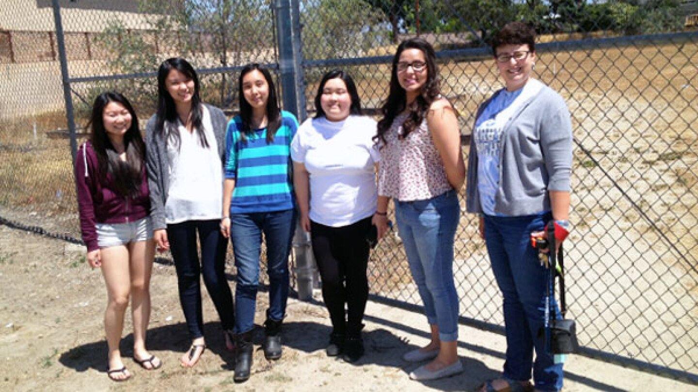 Student Gardner: Savanna, Mabel, Tiffany, Stephanie, and Brianna with Ms. Jennifer Swanson, Knights Garden Adviser