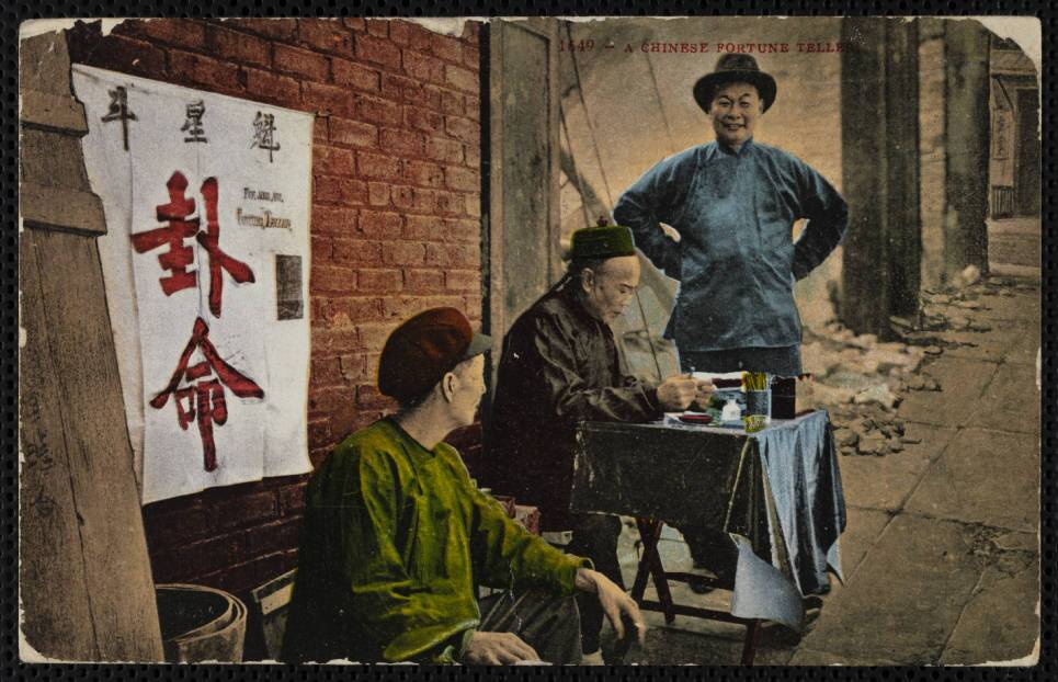 """A color postcard depicts a """"Chinese fortune teller"""" and two other men, all in traditional clothing"""