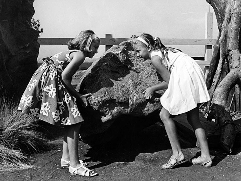 Visitors interact with a movie prop boulder | Valley Times Collection at Los Angeles Public Library