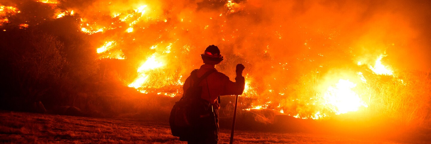 A firefighter works at the scene of the Bobcat Fire burning on hillsides near Monrovia Canyon Park in Monrovia, California on September 15, 2020. | Photo by RINGO CHIU/AFP via Getty Images