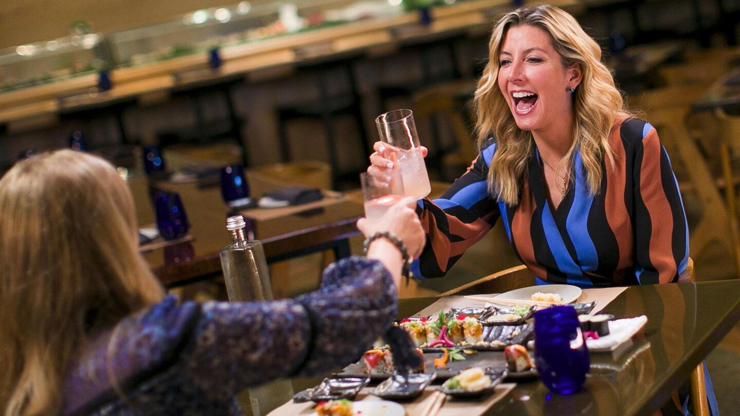 """Sara Blakely and Kate Sullivan do a cheers on """"To Dine For with Kate Sullivan."""""""