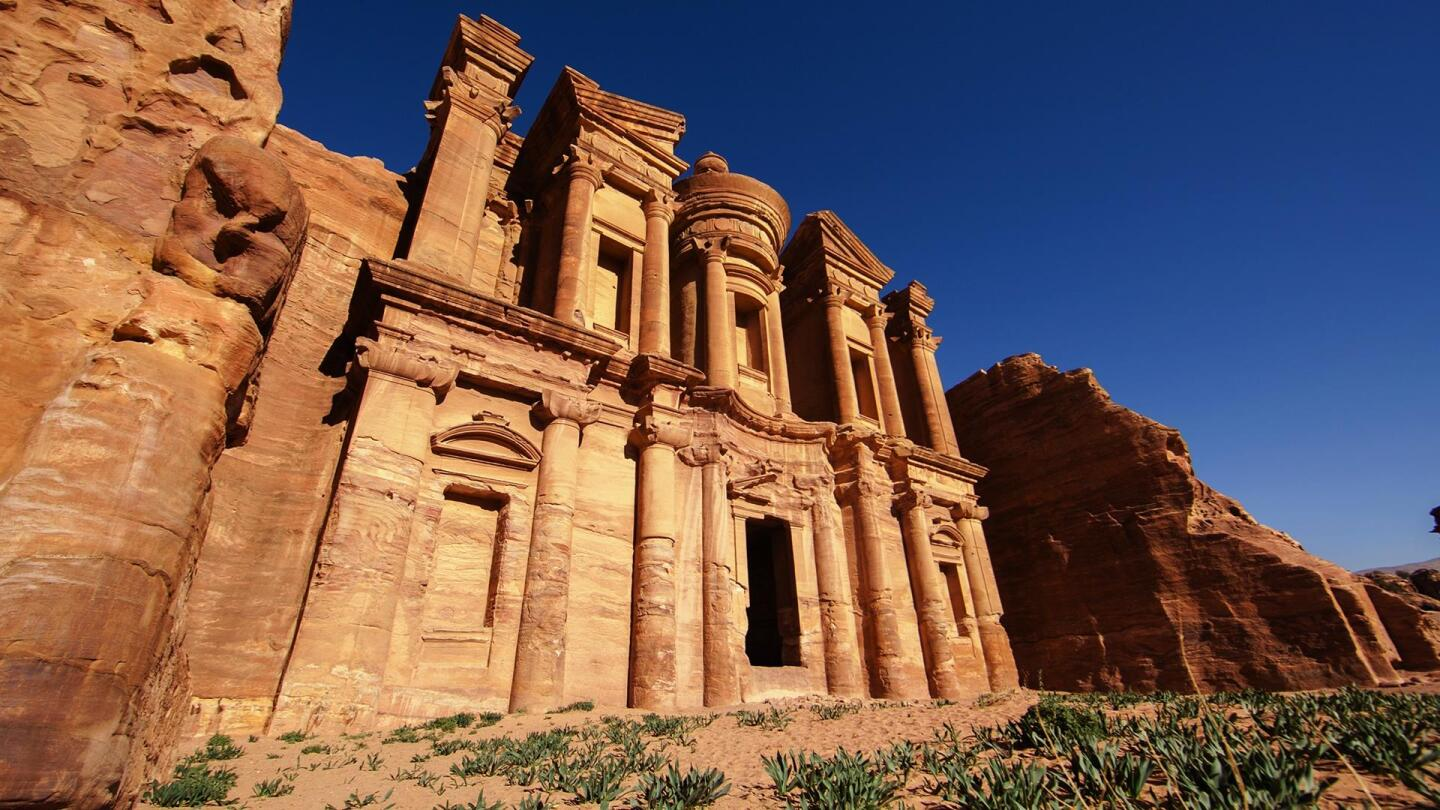 "Walls of an ancient city made of red stone. | From ""NOVA: Petra - Lost City of Stone"""
