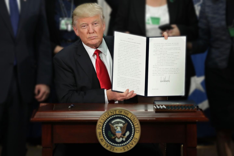 Pres. Trump Displays Executive Order Signed Jan. 25, 2017 | photo Chip Somodevilla/Getty Images