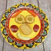 A smiley face made out of food items on a yellow paper plate