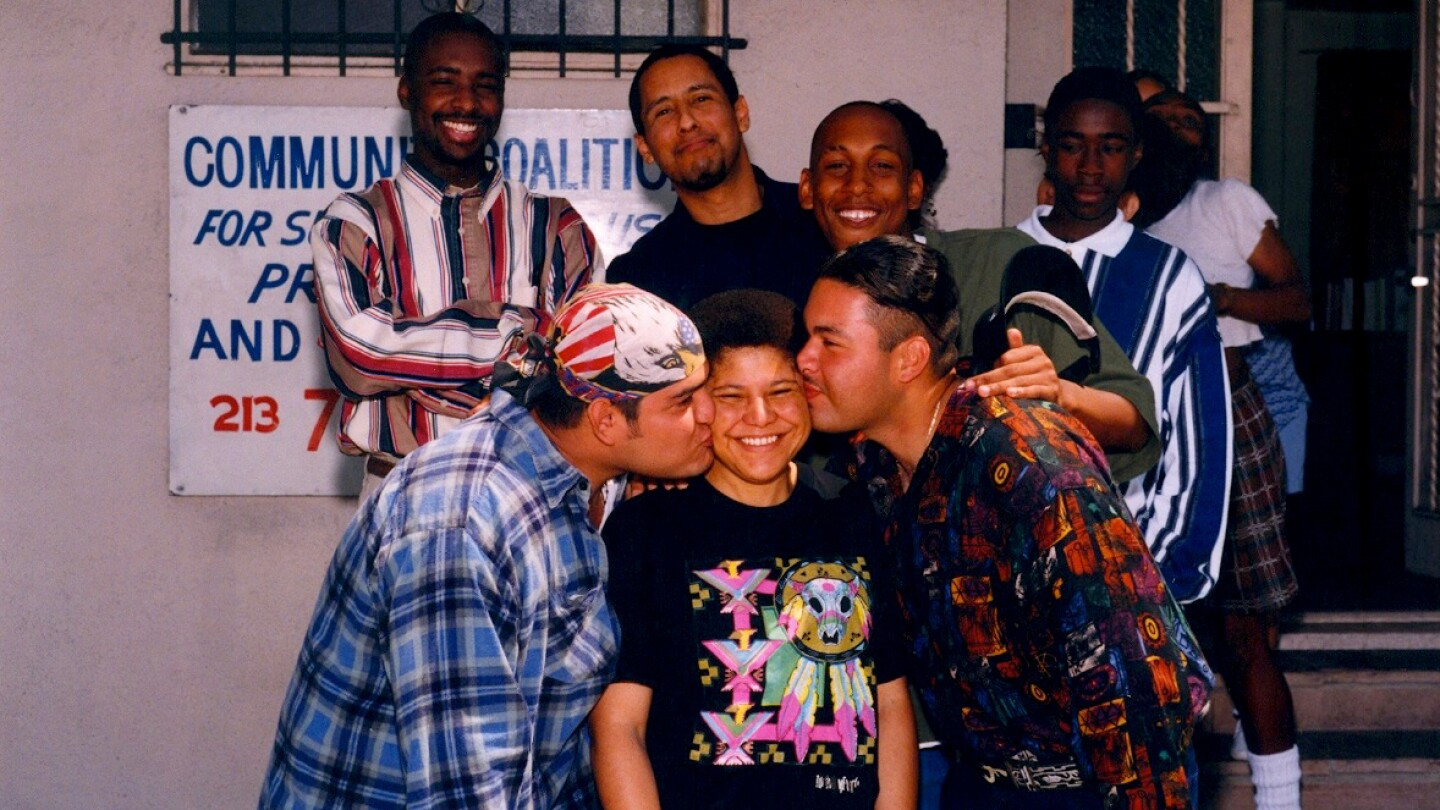 Now Congresswoman Karen Bass (center) and co-author Marqueece Harris Dawson top left corner, and other SCYEA youth in the 1990s.   Community Coalition