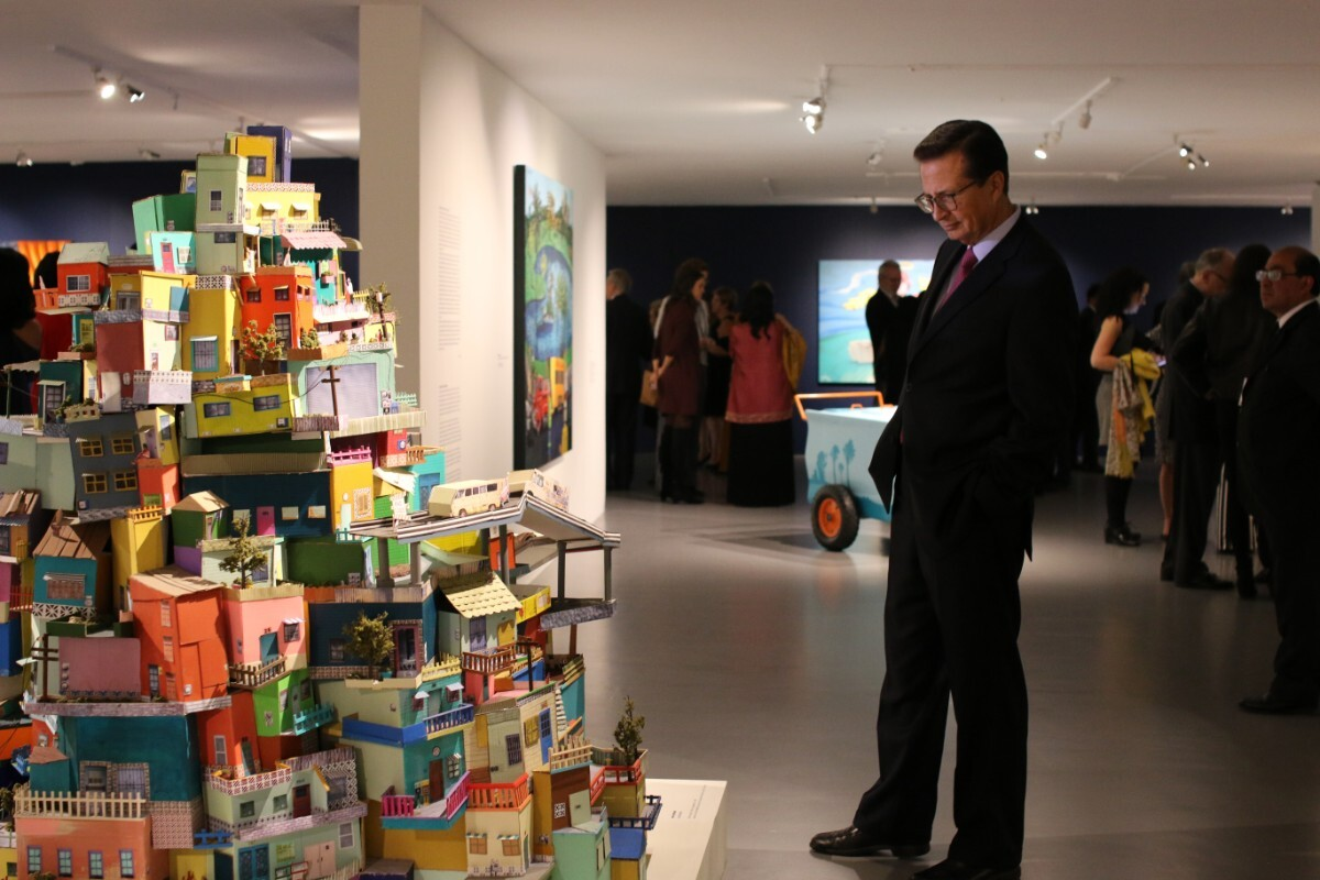 "Visitor views Ana Serrano's ""Cartonlandia,"" 2008 | Samanta Helou Hernandez"