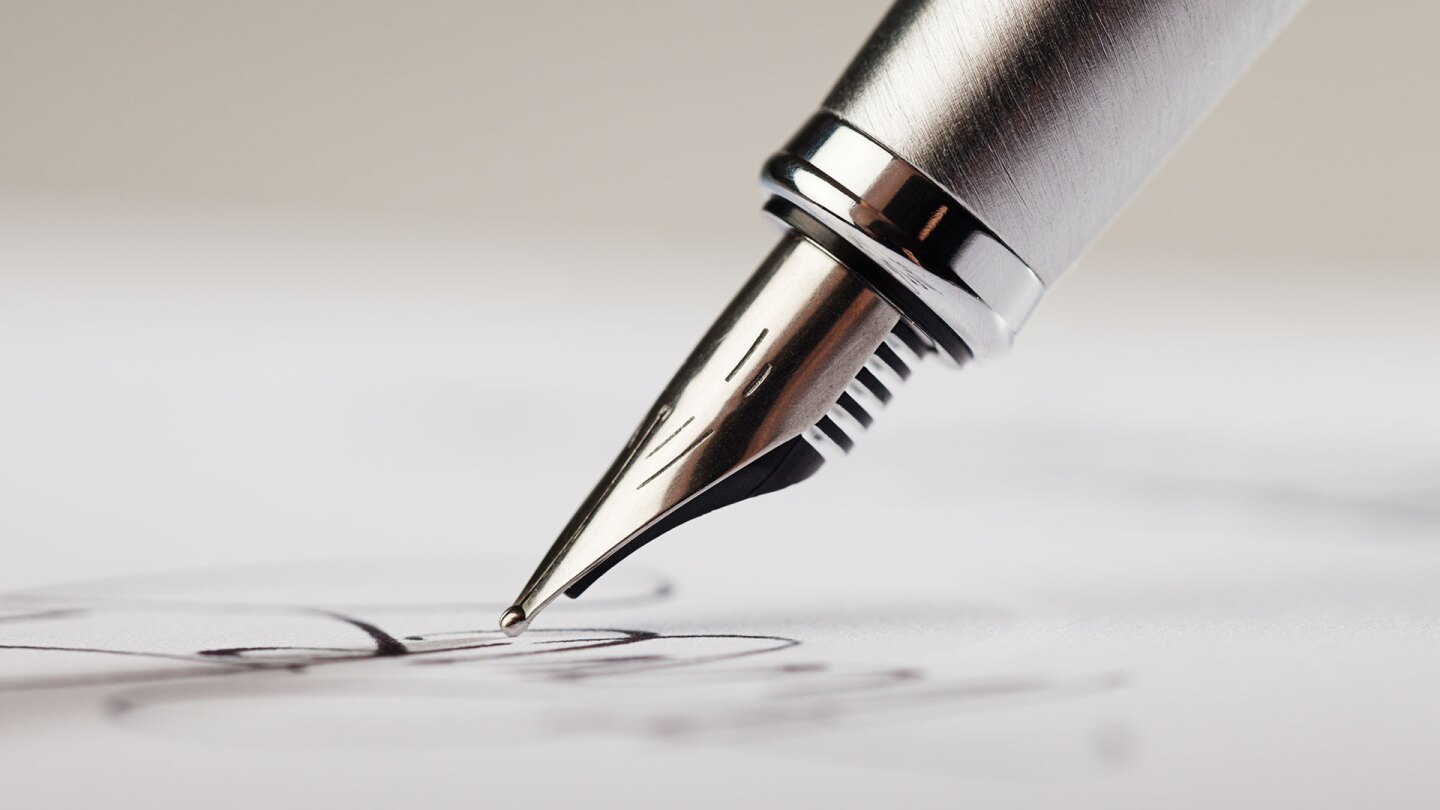 Fountain Pen Signing a Paper