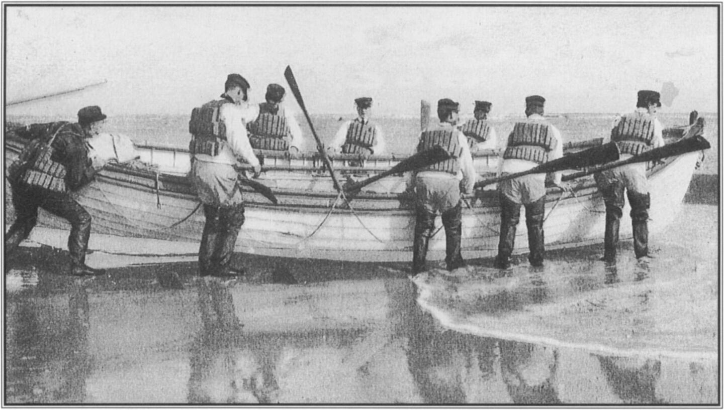 On Atlantic beaches, lifesaving involved time-consuming and arduous preparation including the donning of full-body gear prior to launching the craft originally conceived as a shipboard lifeboat. Courtesy Arthur  C. Verge.