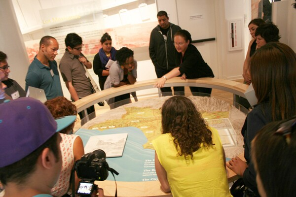 Cindi Dale shows the teaching artist a map of the 19th century Californio Ranchos at La Plaza