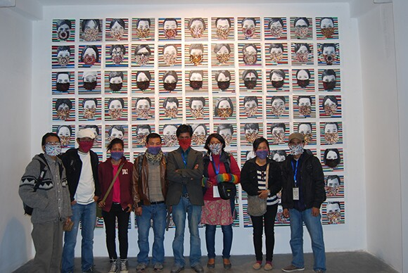 """Hit Man Gurung with his students and friends in front of """"How Long Can I Hold My Breath...,"""" 2012.   Courtesy of the artist."""