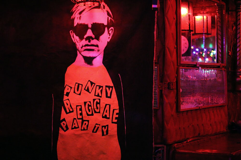 """Poster of a man with sunglasses and a shirt reading """"Punky Reggae Party."""""""