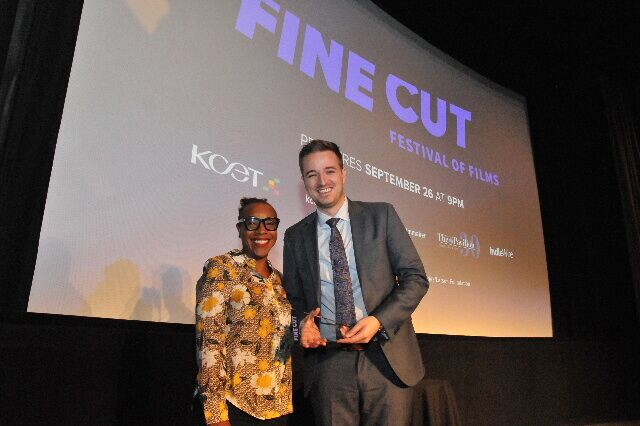 Winner for 'Best Narrative Film' Derek Tonks, who accepted the award on Aqsa Altaf's behalf, with Actress Marianne Jean-Baptiste