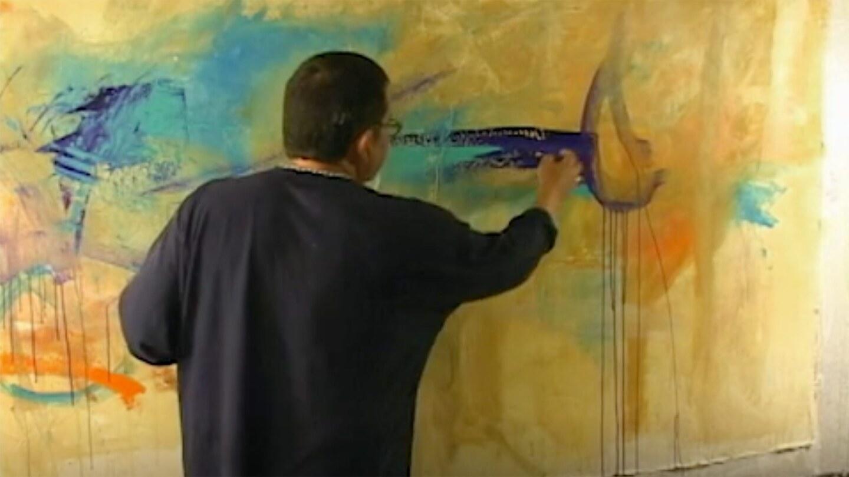 Juan Farias paints.
