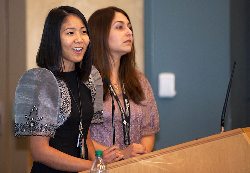 Josephine Santiago-Bond and Alyssa Garcia, of Kennedy Space Center's Asian Pacific American Connection Employee Resource Group speak to attendees at theannual Asian-American Pacific Islander Heritage Month event. | Flickr/NASA Kennedy/Creative Commons(CC BY-NC-ND 2.0)