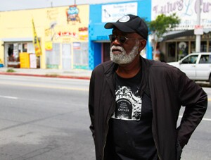 Ben Caldwell conducts field research noting the locations of underused and destroyed phones on Central Avenue, the old centre of Jazz in South L.A.   Photo: Karl Baumann