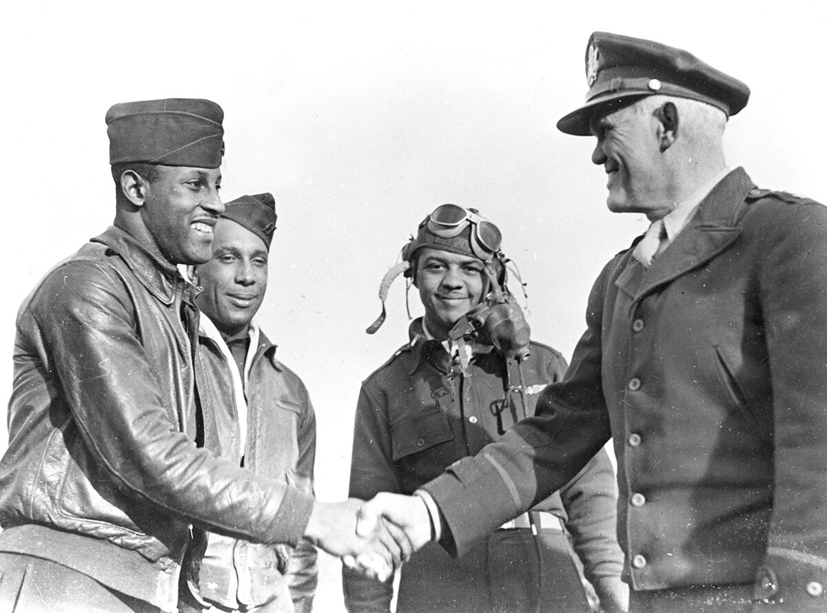 Capt. Charles B. Hall (left), the first Tuskegee Airman to shoot down an enemy plane, is congratulated by Maj. Gen. John Kenneth Cannon. | Courtesy of U.S. Air Force