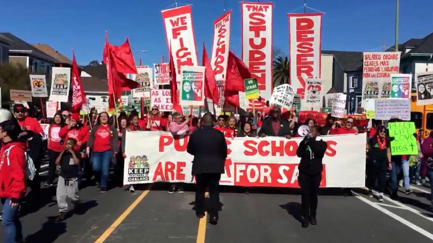 "People marching during the Oakland teacher strike. | Still from ""City Rising: Youth & Democracy"""