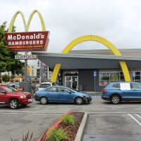 Cars in drive thru line at McDonalds on Crenshaw Blvd, during a protest for pay after coworker tested for coronavirus | Karen Foshay