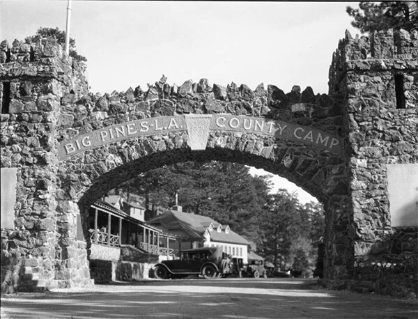 Close-up view of arched entryway of Big Pines camp. | Digitally reproduced by the USC Digital Library; From the California Historical Society Collection at the University of Southern California