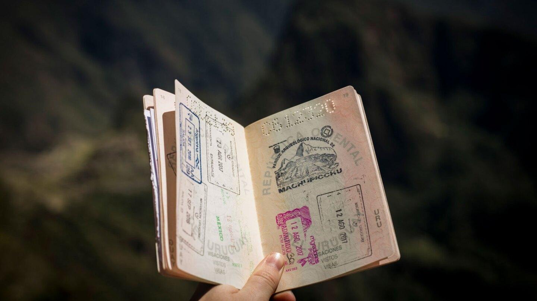 Person holding a passport | Aegus Dietrich / Unsplash