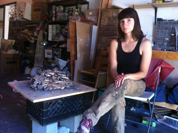 Liz Glynn in her studio with her ceramic copy (in progress) of the Salisbury Hoard | Photo: Sharon Mizota.
