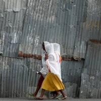 FILE PHOTO: Orthodox women walk along the street to attend a Friday evening prayer in Hawassa, Ethiopia, November 22, 2019. | REUTERS/Tiksa Negeri