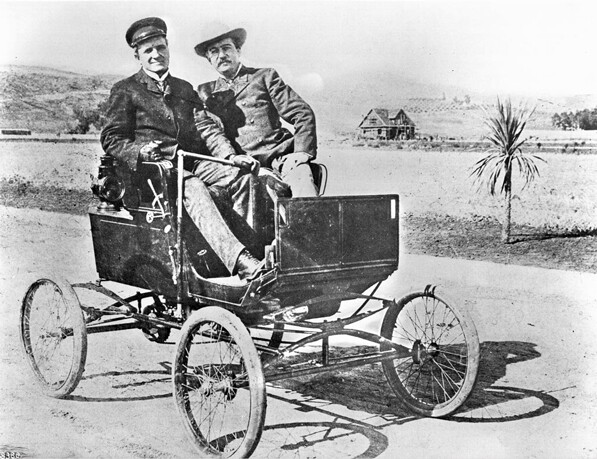 Moses H. Sherman sits at the wheel of a Mobile Stanhope Steamer on Hollywood Boulevard with Sheriff Bill Hammel, 1900. Courtesy of the Title Insurance and Trust / C.C. Pierce Photography Collection, USC Libraries.