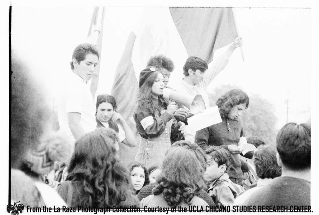 CSRC_LaRaza_B15F10C1_Staff_025 Protesters at Franklin D. Roosevelt Park rally   Maria Marquez Sanchez, La Raza photograph collection. Courtesy of UCLA Chicano Studies Research Center