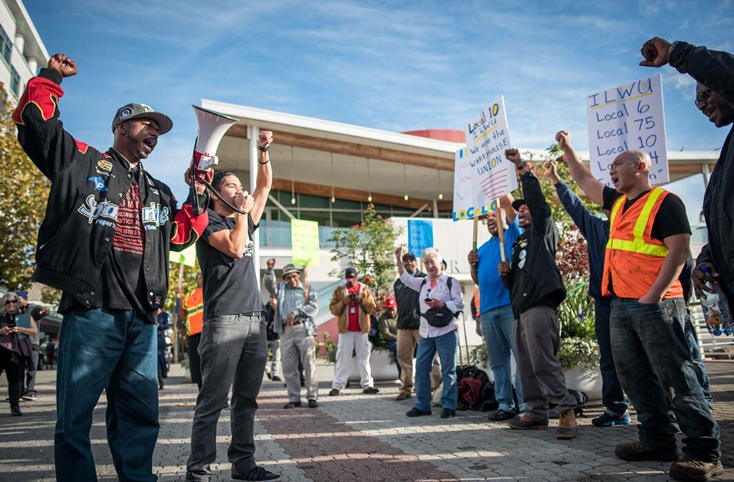 Organizers raise their fist at a union rally in Oakland. | Brooke Anderson
