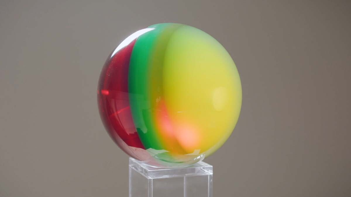 "A multi-colored sphere by Helen Pashgian. | Still from Artbound ""Light & Space"" ab s11"