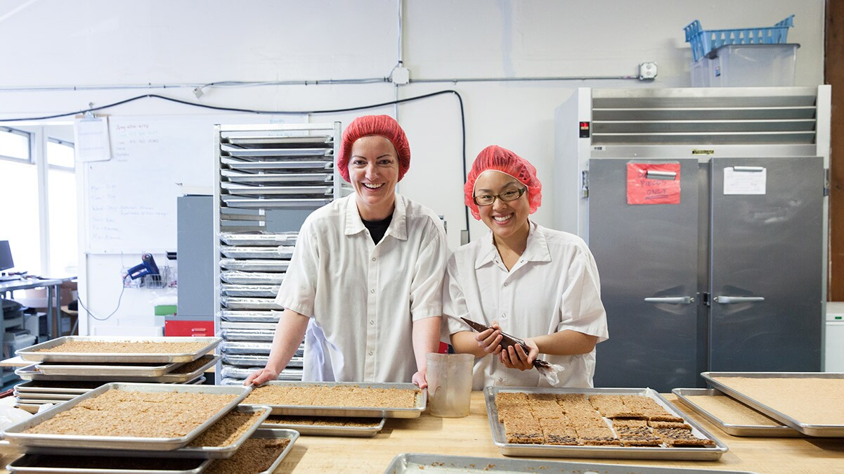 Claire Keane, Owner of Clairesquares in her production facility | Sarah Peet Photography
