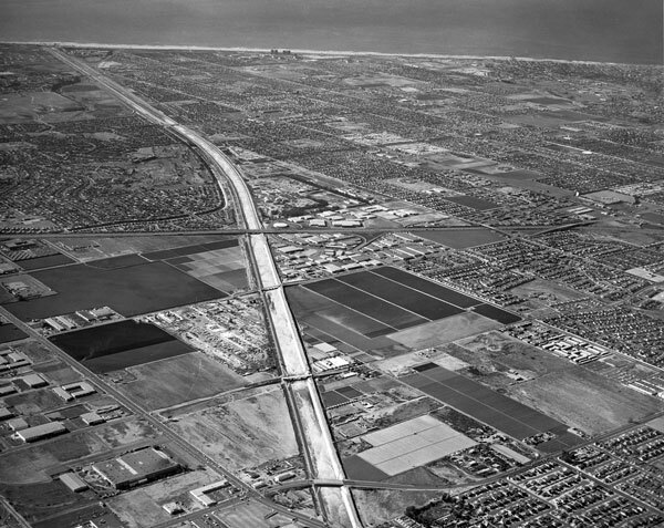 1974 aerial view of the Santa Ana River near its outlet, where it is confined to a flood control channel. Courtesy of the Orange County Archives.