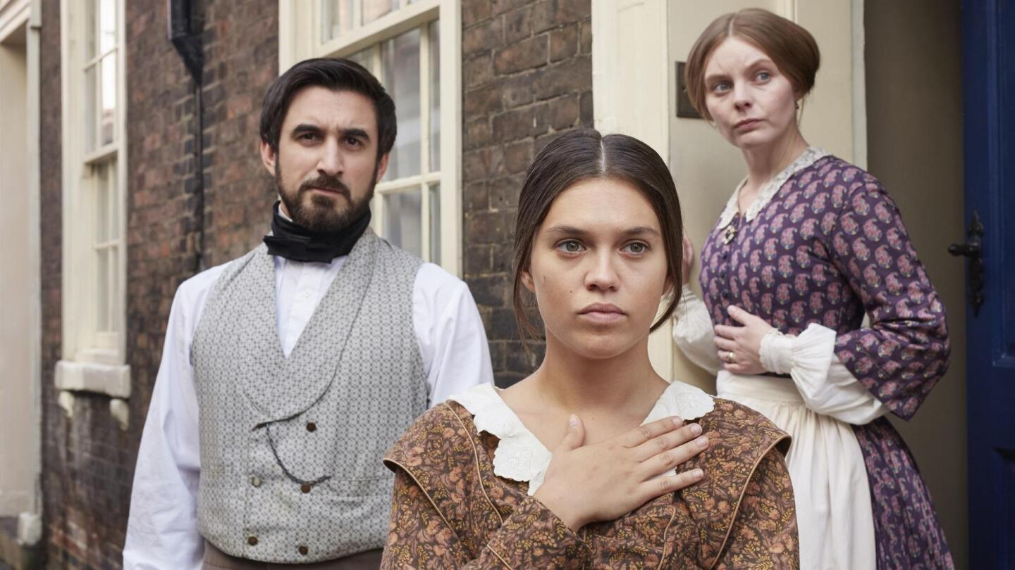 "Charles Francatelli (Ferdinand Kingsley), Nancy Skerrett (Nell Hudson) and Abigail Turner (Sabrina Bartlett) look in the same direction at something outside the house. | ""Victoria Season 3 on Masterpiece: Foreign Bodies"""