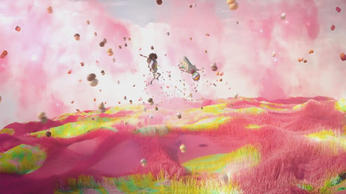 "Still from ""Made of Love:"" Two figures fly over sky and grass of pink and purple."