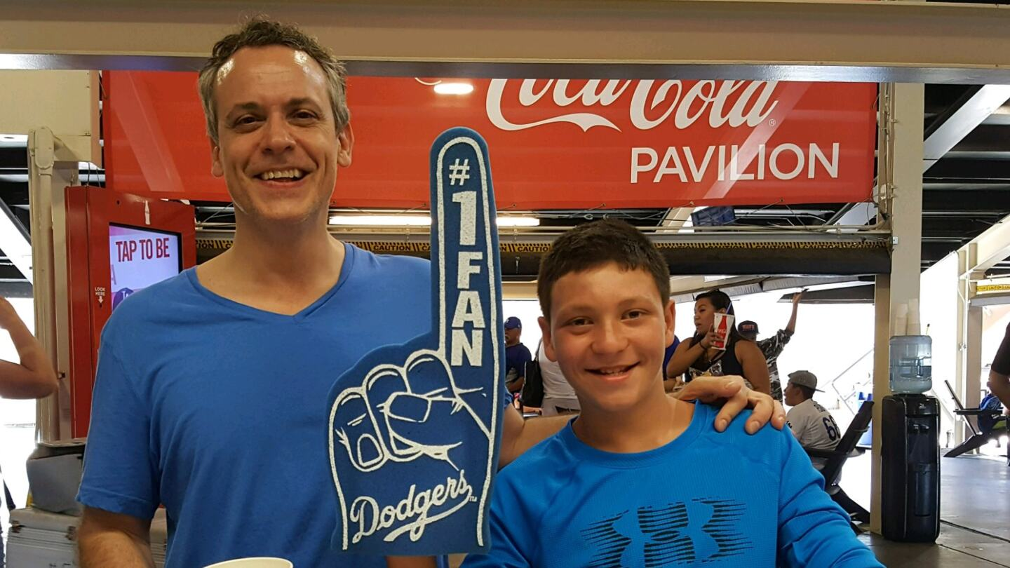 Pete Gragnani and a foster youth at a Dodger Game