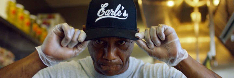 "Duane Earl shows his Earl's cap. | Still from ""Broken Bread"""