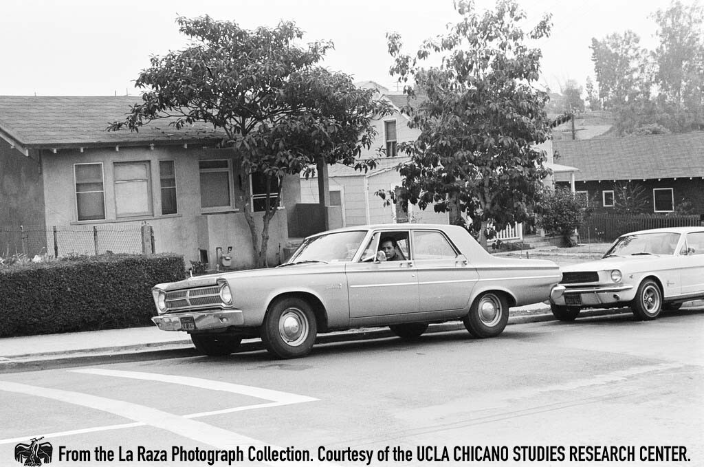 CSRC_LaRaza_B1F3C2_DW_005 Men in a car during the Roosevelt High School walkouts | Devra Weber, La Raza photograph collection. Courtesy of UCLA Chicano Studies Research Center