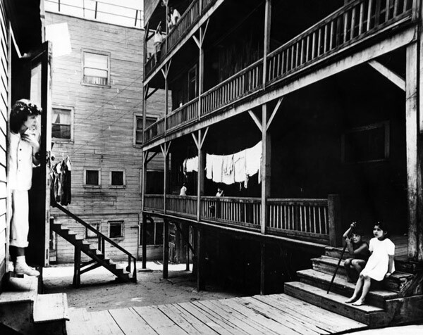 1948 view of dwellings deemed 'slum apartments.' Courtesy of the Photo Collection, Los Angeles Public Library.