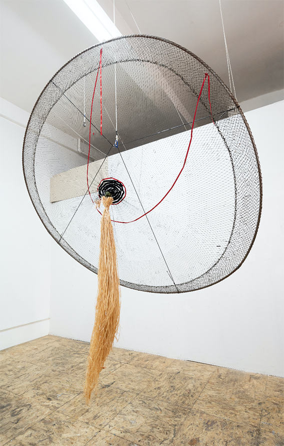 Milk, 2018 Form the Cosmotarrayas Series Tar dipped artisanal fishing net, lead weights, carabineer, metal ring, paracord, ribbon, raffia 96 x 96 x 35 inches Courtesy of the artist and Instituto de Visión.png