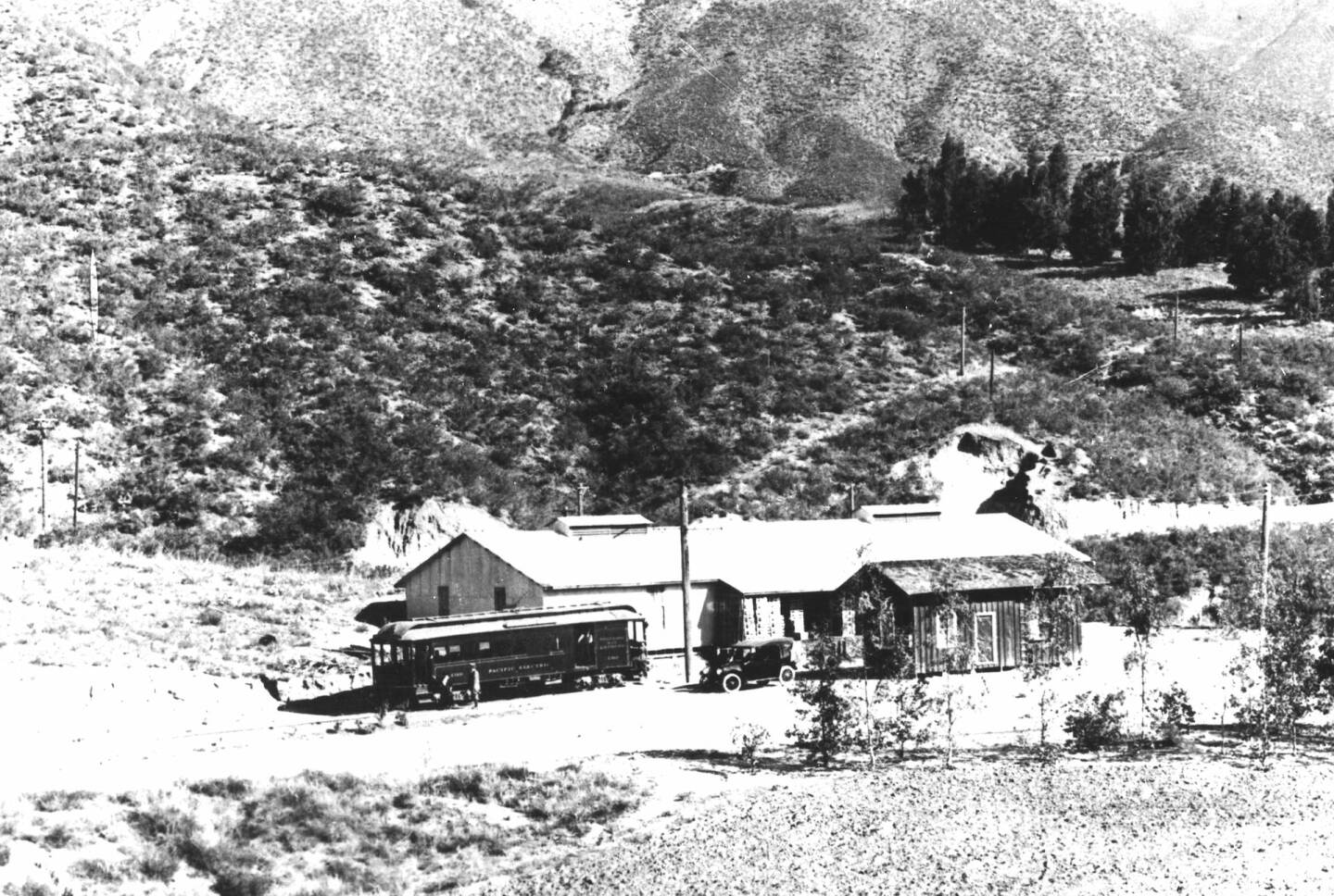 Trolley and automobile parked outside Arrowhead Water Company, Arrowhead Springs, ca.1914