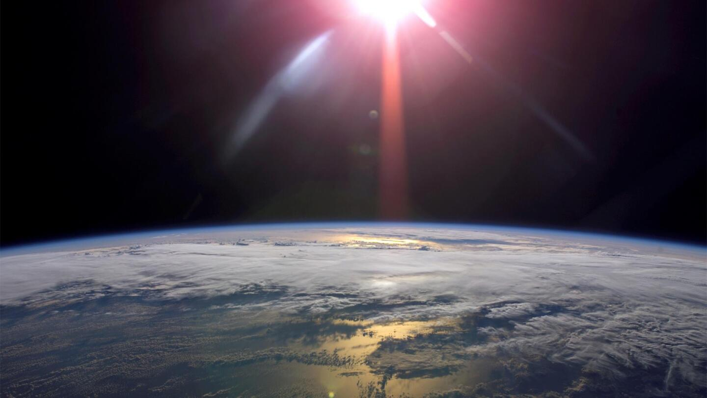 "The sun from outer space shines down on Earth. | From ""NOVA: Can We Cool the Planet?"""