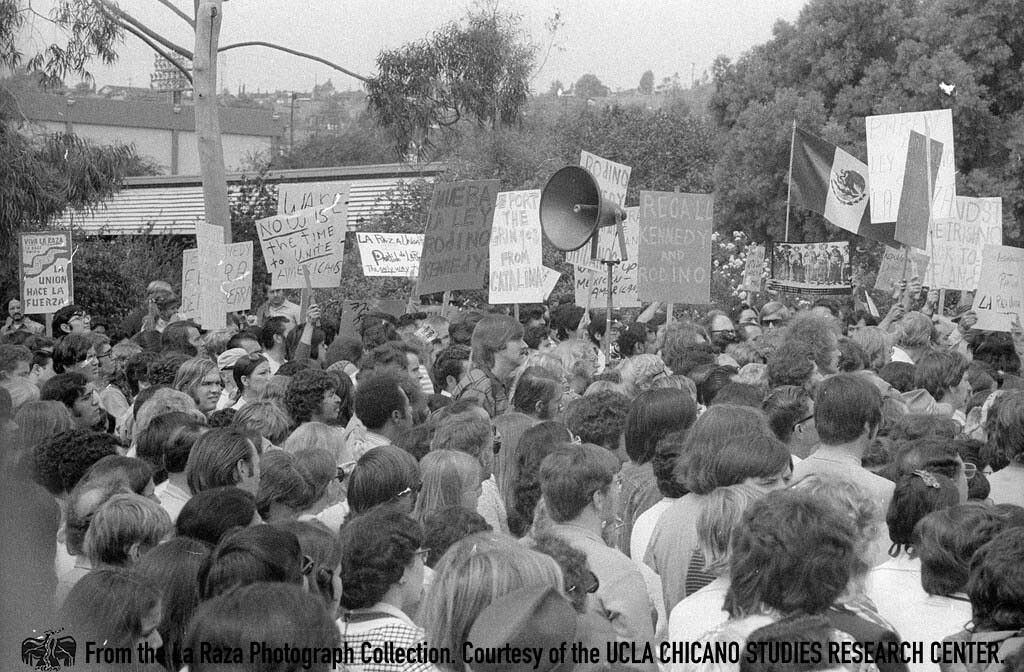 CSRC_LaRaza_B13F1S1_N018 Crowd gathers during McGovern and Shriver Presidential Rally  | Patricia Borjon Lopez, La Raza photograph collection. Courtesy of UCLA Chicano Studies Research Center