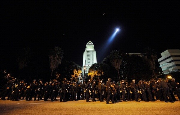 Hundreds of LAPD officers wait to walk into the Occupy Los Angeles protest encampment following the November 30, 2011 raid. | Photo by Kevork Djansezian/Getty Images)