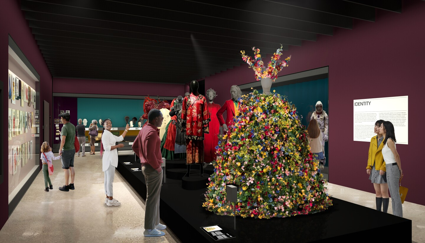 """A rendering of the identity gallery in """"Stories of Cinema"""" at the Academy Museum of Motion Pictures set to open Sept. 30. The image depicts museum-goers viewing various costume pieces in films like the floral gown featured in Ari Aster's 2019 film, """"Midsommar."""""""