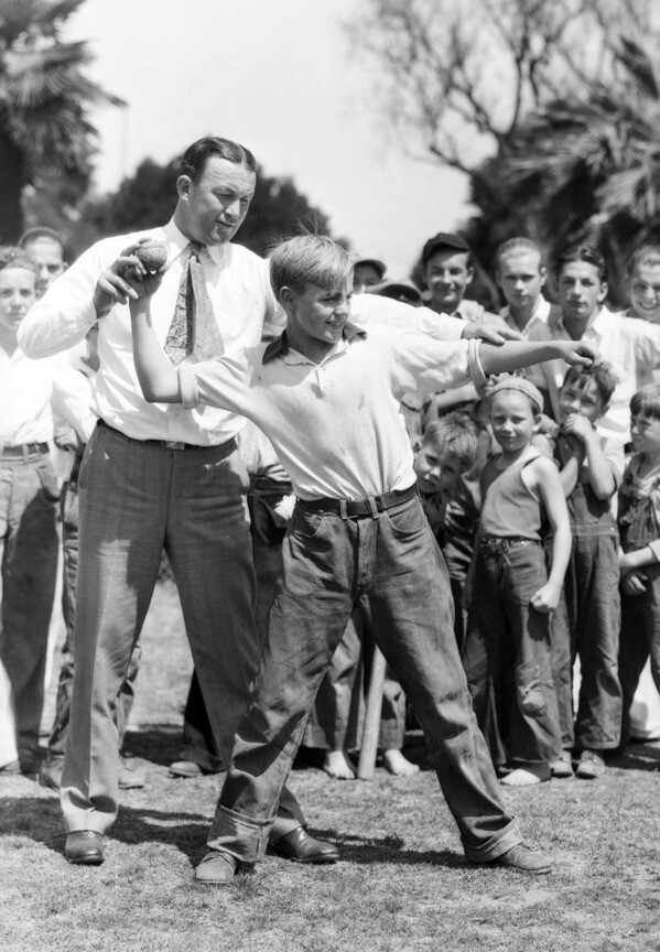 Boys learn to throw baseballs at South Park in 1931. Courtesy of the USC Libraries - Dick Whittington Photography Collection.