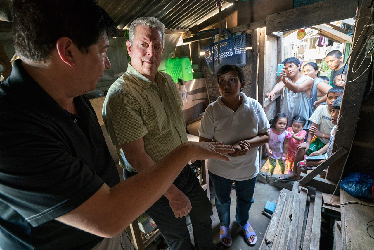 """Al Gore, former Mayor of Tacloban City Alfred Romualdez and Typhoon Haiyan survivor Demi Raya in  """"An Inconvenient Sequel: Truth to Power"""""""