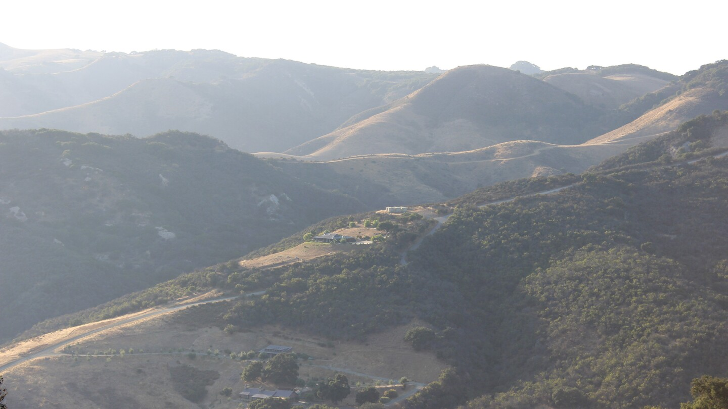 A hazy view of the Santa Ynez mountains and a few buildings in the distance. | Spencer Robins